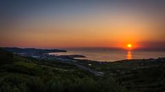 Sunset Over Izola (MuckeInPivo) Tags: sun sunset sea coastline shoreline water vinyards green fields city izola isola slovenia road trees forest colourful evening beautiful tranquility peaceful