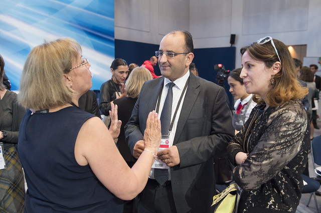 Eva Molnar discussing with Anis Ghedira