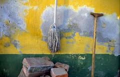 still (.e.e.e.) Tags: stilllife crutch yellow green brick swab mop olympusom4ti zuiko1850 agfaprecisa100 dia slide slidefilm analog analogue film filmscan epsonv350photoscanner explore