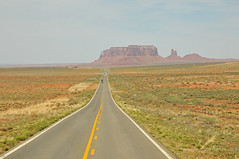Approaching Monument Valley (Vee living life to the full) Tags: nevada utah arizona distance layers limestone sandstone water evaporation disintegration weathering leger erosion roads route american vehicle rocks rock cliff sheer drop threat danger police mountains skyline horizon sitting geology sedimentary compression uplift wild road formation sky blue monuments valley death usa nationalpark long blackandwhite panorama