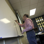 Dr. Fischmar taking notes on the white board.