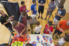 Choose Your Weapons - Blaster Tag (aaronrhawkins) Tags: blaster tag blastertag nerf darts guns party shoot team teams mattstott research group church vest load kids students fun victory gun table aaronhawkins provo utah gym basketball court foam bullet