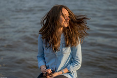 Enlighted by a golden sun (Vagabundina) Tags: portrait person personality persona girl woman light sun goldenhour hair movement hamburg germany elbe river water nikond5300 dsrl nikon atmosphere ambience