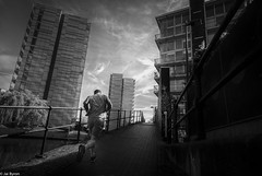 Pushing Onwards (kungfuslippers) Tags: manchester castlefield jogging streetphotography mono wideangle