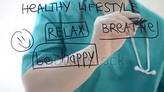 Healthy lifestyle. (daria.boteva) Tags: arm board concept consultant consultation diagram doctor drawing drink eating exercising female fitness food hand health healthy hospital lecture lecturer life lifestyle lowfat marker medical medicine nutrition nutritional pen person phonendoscope physician presentation reducing stress treatment vertical vitamin water woman writing