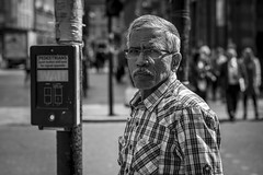 Pedestrian (Leanne Boulton) Tags: people monochrome portrait urban street candid portraiture streetphotography candidstreetphotography streetportrait candidportrait streetlife eyecontact candideyecontact man male face facial expression eyes look emotion feeling mood tone texture detail depthoffield bokeh naturallight outdoor light shade shadow sunlight city scene human life living humanity society culture canon canon5d 5dmarkiii 70mm character ef2470mmf28liiusm black white blackwhite bw mono blackandwhite glasgow scotland uk