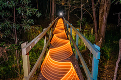 Peachy Ribbon (stephenk1977) Tags: australia queensland qld brisbane banksstreetreserve alderley forest woodland bridge wood trees night lightpainting art photography nikon d3300 lightflute universalconnector wand light starburst cellophane
