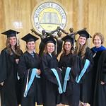 Graduates pose in Orr lobby