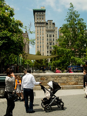 Union Square Narrow High Rise (lifeofstawa) Tags: nyc buildings chaos green highrise juxtaposed order ornate park people thin trees