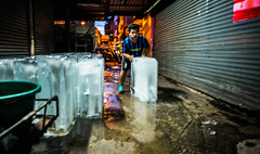 Ice (Phg Voyager) Tags: bangkok city asia thailand urban ice boy girl urbanscape night light color leica mp 24mm phgvoyager street icecube hot dark narrow busy working hard push corridor selling lowlight longexposure chinatown oldcity shops closed ironcurtain