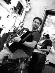 The Hears playing in Pisa (maxrevellation) Tags: streetmusic busking street music acoustic band thehears pisa tuscany toscana italia musica accordion guitar vox drums instruments streetphotography monochrome bw blackwhite