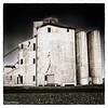Against The Grain (WayneToTheMax) Tags: grain silo elevator rail railroad tracks gravel black white tone dark nikon d750 texas