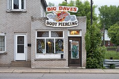 big dave's (twurdemann) Tags: architecture bigdaves bodypiercing city closed detailextractor evening fujixt1 nikcolorefex procontrast rain saultstemarie steelton street tattoos urban weather xf55200