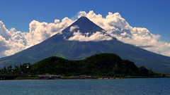 The Sleeping Lion Mountain on the foreground of Mayon Volcano (joelCgarcia) Tags: mayonvolcano legazpicityalbay bicol philippines lumixlx5 thesleepinglion legazpiboulevardlegazpicityalbay sea clouds