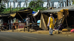 Market under the rails (HopingHigh) Tags: people man yellow color business working india