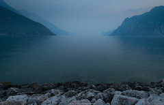 It's not a lake... It's an ocean. (laurilehtophotography) Tags: 2017 italia nikond610 italy lakegarda rivadelgarda travel travelphotography laurilehtophotography instagram landscape nature mountains mist fog evening dark rocks water moody europe world earth amazing tamron 2470mm summer horizon explore