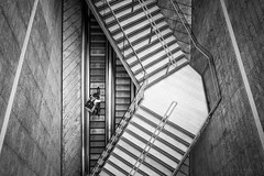 The Cyclist (laura.hacking) Tags: street decisivemoment liverpool aerial fromabove blackandwhite symmetry stairs appicoftheweek architecture modern texture oneperson monochrome alone