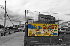 William's Candy (Coney Island) (Robert S. Photography) Tags: candy bw selectivecolor street fence chair clouds coneyisland brooklyn nyc nikon coolpix l340 iso80 may 2017