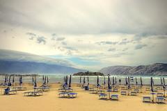 It must be winter (cristi_foto) Tags: sea beach umbrella golf mountain clouds island water