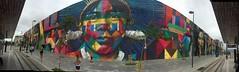 Olympic feat  . . . (ericrstoner) Tags: eduardokobra mural graffiti theethnicities etnias riodejaneiro portomaravilha rioolympics vlt paradadosnavios lightrail guanabarabay baíadeguanabara panorama streetart streetmural