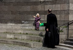 The woman and the priest (andersåkerblom) Tags: sitting point man woman priest city urban street