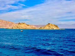 Pharaoh's Island, Sinai Peninsula, Egypt (WorldExplorations) Tags: landscape hills beach clouds sky bluesky unesco worldheritage unescoworldheritagesite ancient history historic historicsite water shoreline shore coastline coast aqaba gulf gulfofaqaba sea redsea stone fort castle saladin citadel citadelofsaladin desert middleeast egypt peninsula sinai sinaipeninsula island pharaoh pharaohsisland