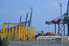 TOGO, WEST AFRICA:    YELLOW CRANES ON LOME'S WHARF,  TOGO,  AFRICA. (vermillion$baby) Tags: containerhoist africa container crane done flickr green hoist lome pier togo wharf yellow ocean sea westafrica togosea port cranef dock transportation wharves
