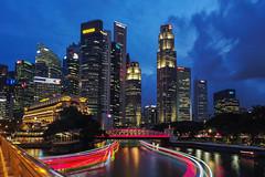 Riverfront (elenaleong) Tags: esplandebridge bluehour riverfront singaporeriver boattrails traffictrails cityscape skyscrapers elenaleong