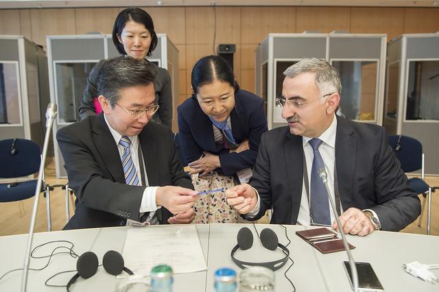 Hiroshi Tabata and Elmir Velizadeh exchange cards