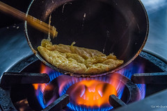 2017 - HAL Volendam Cruise - Yokohama  Omelette Making 101 (Ted's photos - For Me & You) Tags: japan nikon nikond750 nikonfx tedmcgrath tedsphotos vignetting yokohama 2017 yokohamajapan wok chopsticks cooking flame gas burner blueflame kitchen stove gascooktop gasflame cropped food