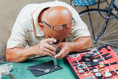 Watch repair service at the flea market (Evgeny Ermakov) Tags: asia asian kualalumpur malaysia bazar business candid clock clockmaker closeup fix fleamarket hand hands man market marketplace old red repair retro street time vibrant vintage watch watchmaker editorialuse