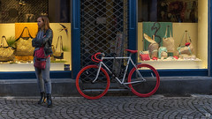 Red wheels and high heels (BAN - photography) Tags: attractivewoman bicycle redwheels boots leatherjacket fashion handbags pavers windowdressing boutique d810 strasbourg oldtown