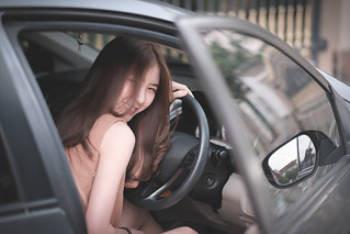 Portrait with smiling cute girl in her car