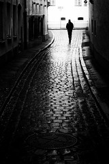 a rainy day (Sandy...J) Tags: atmosphere alone walking rain monochrom blackwhite streetphotography urban noir darkness light man