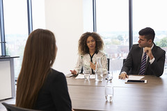 Female Candidate Being Interviewed For Position In Office (solentevents) Tags: interview recruitment candidate business businessman businesswoman businesspeople meeting discussion talking office sitting working together threepeople people person man men male woman women female indoors mixedrace africanamerican black caucasian middleeastern asian multicultural diversity twenties 20s horizontal jobinterview viewfrombehind