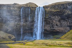 Another of Iceland's Many Iconic Waterfalls (Herculeus.) Tags: 2017 april cliffs country day europe hills iceland landscape landscapes mist outdoor outdoors outside people seljalandsfossiceland sightseers spring waterfalls wind 5photosaday