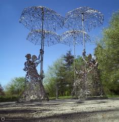 Love In The Rain (PiscesDreamer) Tags: loveintherain lovelocks brucevoice sculpture art love queenelizabethpark vancouver britishcolumbia canada umbrella couple