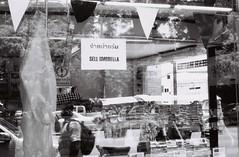 SELL UMBRELLA (jcbkk1956) Tags: street bangkok thonglo thailand carlzeiss 45mmf28 167mt contax manualfocus film 35mm analog reflections sell umbrella blackandwhite mono window shop worldtrekker