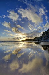 The charging sky (pauldunn52) Tags: wet sand traeth mawr glamorgan heritage coast wales reflections clouds sunset