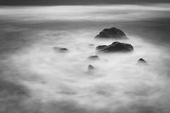 Dark swirl (johaennesy) Tags: longexposure swirl ocean stones monochrome blackandwhite opensourcesoftware gimp rawtherapee lagomera canaryislands canaries canarias sonyalpha sony a580 simple simplistic