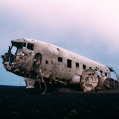 In order to be alone with the Sólheimasandur plane crash I walked to it at three a.m., just as the sun was rising. The Douglas Super DC-3, in operation by the US Navy, went down in 1973. The crew survived and the plane was never recovered. What remains is