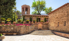 The monastery of the Great Meteoron (stewartl2010) Tags: other sunny greatmeteoron peaceful courtyard meteora structure worldheritagesite bluesky beautiful monastery ornamental ascetic greece colorefexpro4 nikfilters flowers architecture trikala thessaliastereaellada gr
