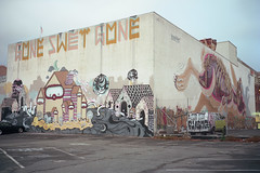 (patrickjoust) Tags: oakland california downtown graffiti mural van fujicagw690 kodakportra160 6x9 medium format 120 rangefinder 90mm f35 fujinon lens c41 color negative film manual focus analog mechanical patrick joust patrickjoust usa us united states north america estados unidos west auto automobile vehicle parking lot art large building kodak portra 160 fujica gw690