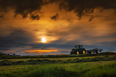 Rowing before Rain (Alan10eden) Tags: row rower rowing swath raking rake claas johndeere tractor ensile grass silage spring northernireland ulster livestock farming winterfeed storage field sky farm farmer agriculture alanhopps canon 80d sigma 1770mm landscape contractor ryegrass wilting wilt drying cut