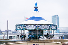 empty carousel in winter near detroit downtown (DigiDreamGrafix.com) Tags: vintage wheel ferris ferriswheel color fun recreational entertainment blue background circle paper sky anniversary day decorative holiday art love travel summer park outdoor abstract texture vivid cardboard grunge old retro turquoise festival wedding wallpaper book artistic artwork ride enjoy carnival seats carousel fair fairground winter cold