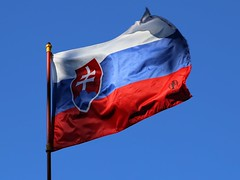 The waving Flag of Slovakia (B℮n) Tags: slovak republic slovenská republika slowakije flag vlag blue red white wapenschild slavic nations coatofarms bratislava independent nation visitors holiday czechoslovakia emblem cross lorraine three hills latin blauw rood wit constitution modern europe centre castle mountains matra tatra fatra sky sunny wind 1992 september colors wapping waving wapperende uefa euro horizontal bands freeze frame sun shadow