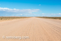 Driving the open road near Solitaire, Namibia, Africa. (Remsberg Photos) Tags: africa namibia world rocky terrain landscape mountains distance clouds empty desert rocks solitaire nam