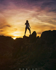 Diana, Triumphant (DonjayPhotos) Tags: people sunset silhouette nature desert rocky amputee inspiration woman active