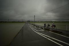 Rainy season. (Yasuyuki Oomagari) Tags: home helmet boys bicycle school rain rainy field cloud nikon d810 carlzeiss zeiss distagont2821 uphill three