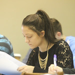 A student reviewing her notes